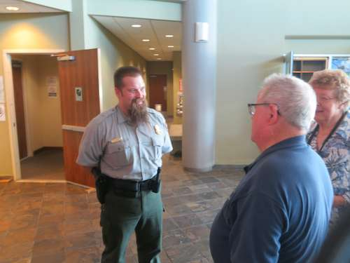Chief Ranger, Jason Beatty greets Lloyd and Judy at Memorial Park Visitors Center